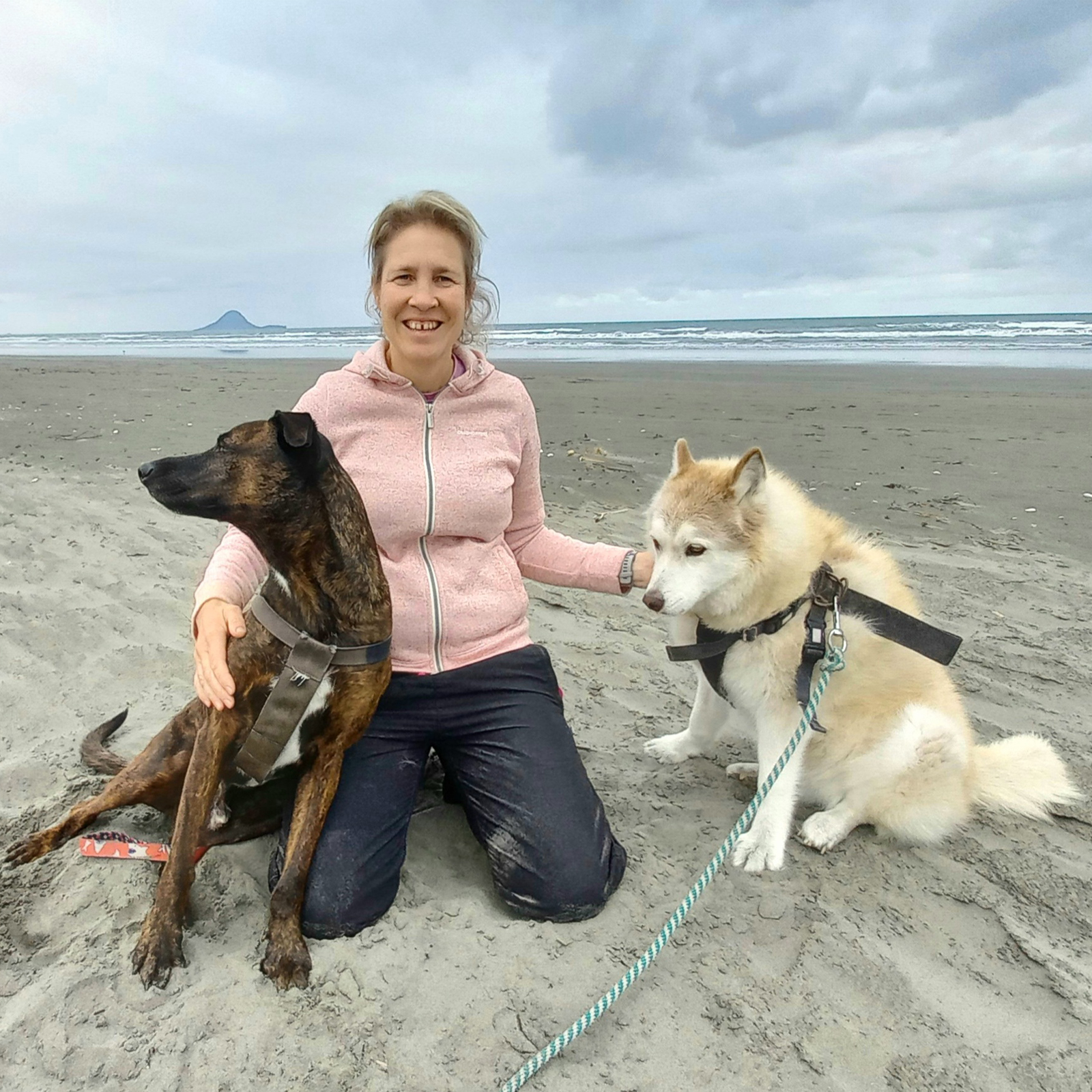Karen on Ohope beach with her dogs